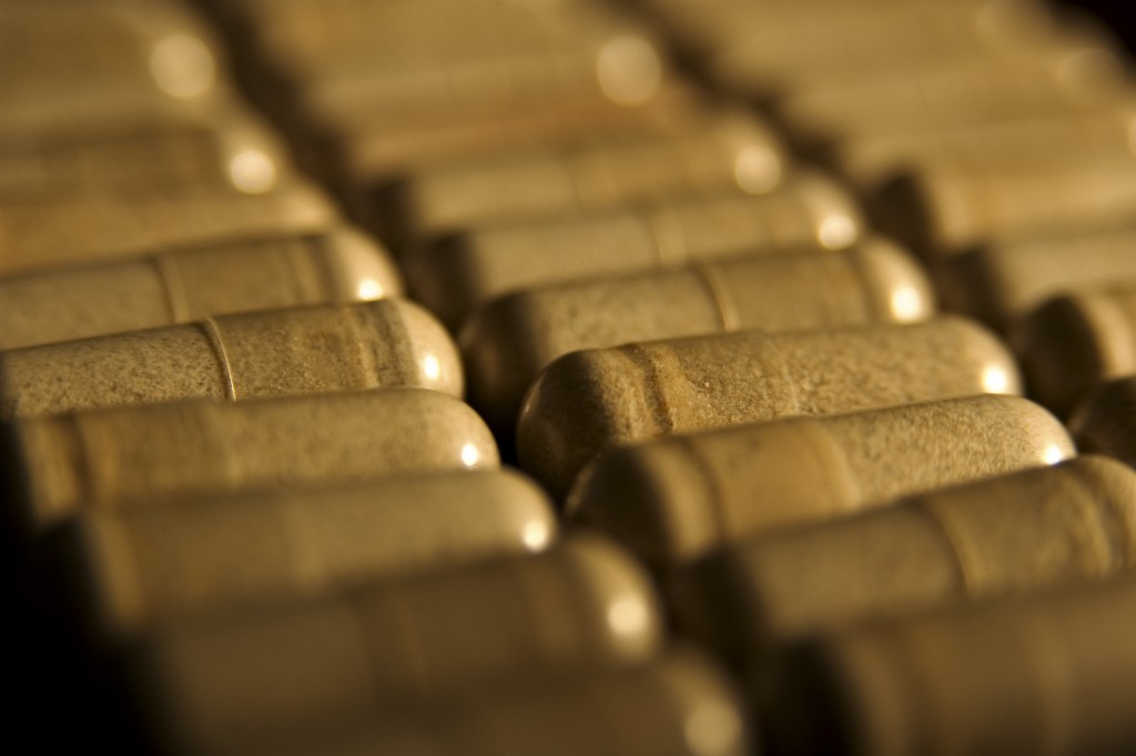 A close-up of capsules lined up in rows